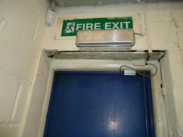 Asbestos Insulating Board above door