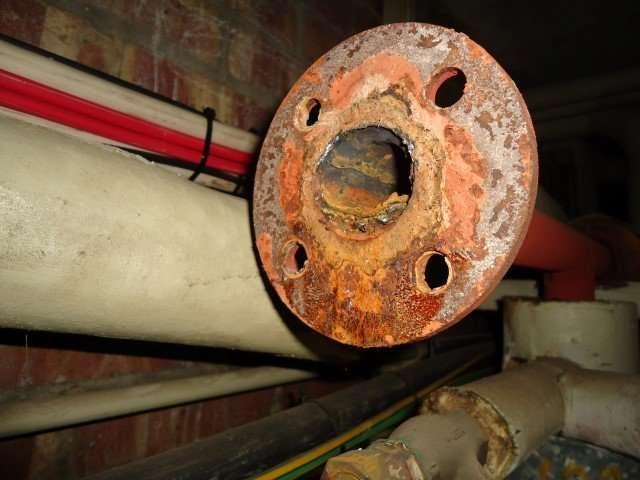 Asbestos CAF gasket residues to flange