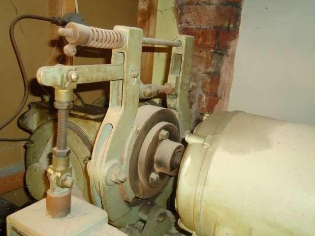 Asbestos cement brakes to lift motor
