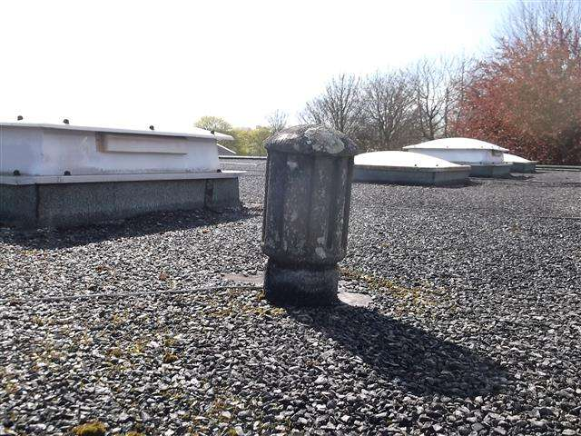 Asbestos cement cowl to pipe on roof