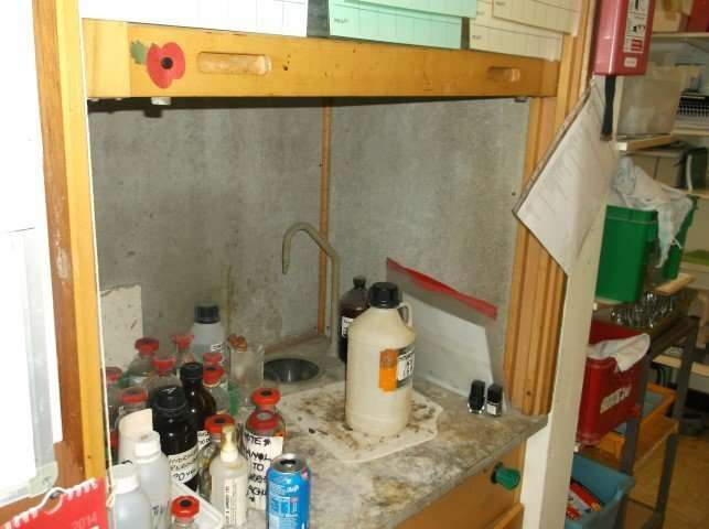 Asbestos cement lining to fume cabinet