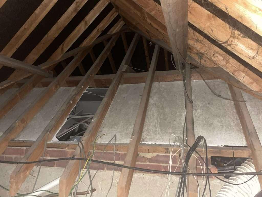 Asbestos cement loft lining firebreak