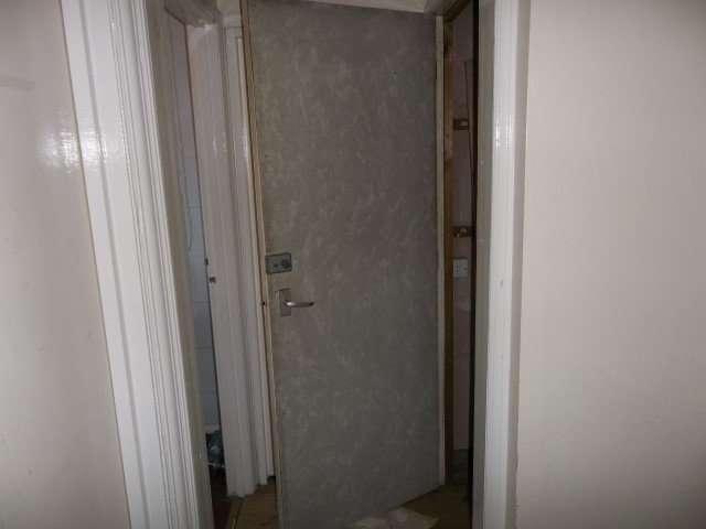 Asbestos cement panel to back of door