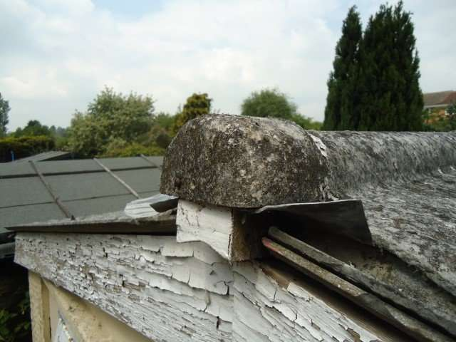Asbestos cement roof end cap