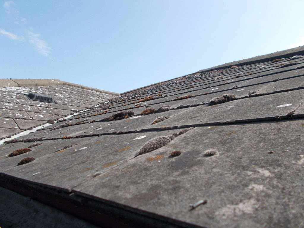 Asbestos cement roof tiles to roof of dentist