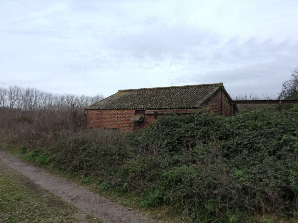 Asbestos cement roof to disused farm building