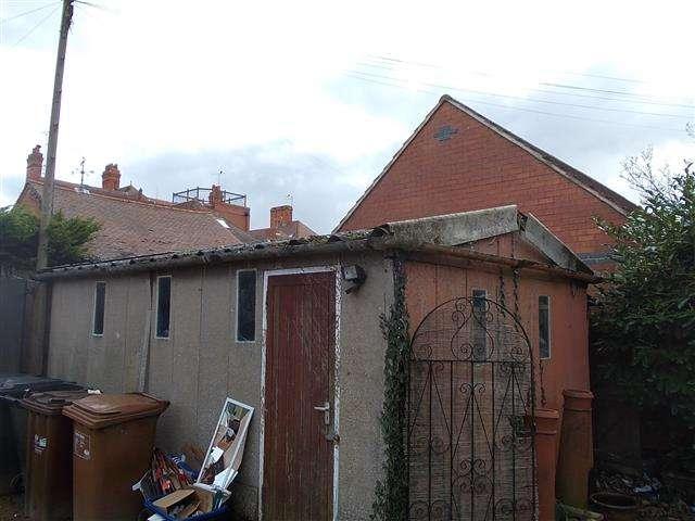 Asbestos cement roof to garage