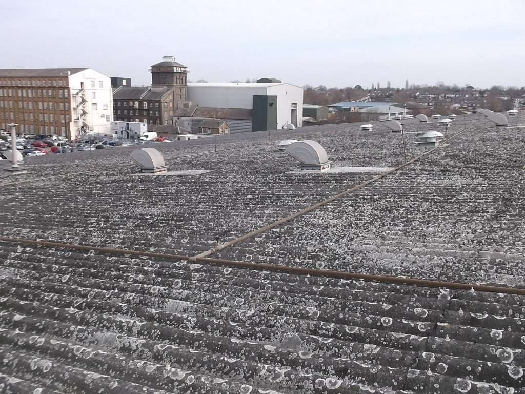 Asbestos cement roof to large warehouse