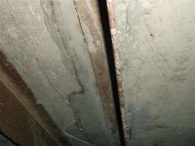 Asbestos cement shuttering to roof of duct