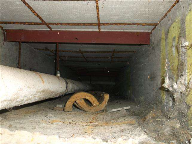 Asbestos cement shuttering to roof of pipe duct