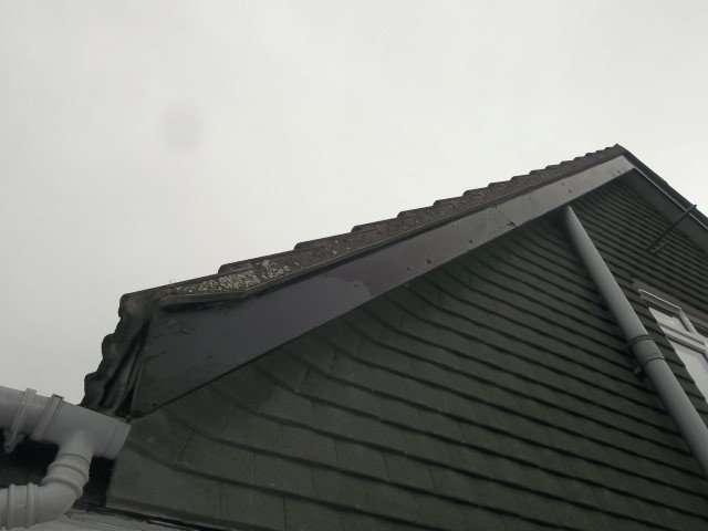 Asbestos cement undercloak to roof