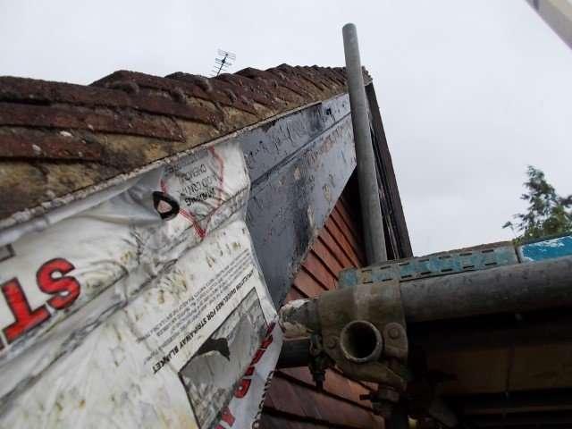 Asbestos cement verge to roof
