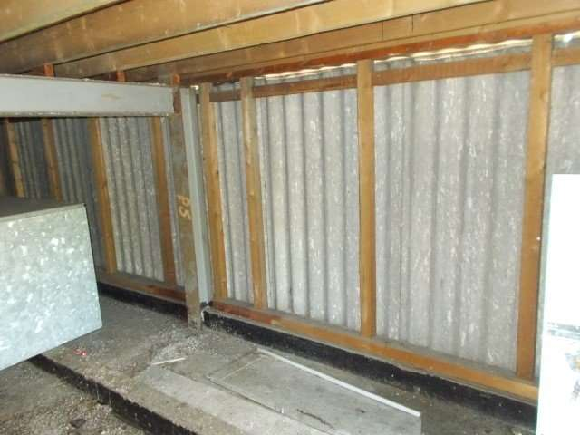 Asbestos cement wall panels to roof tank room