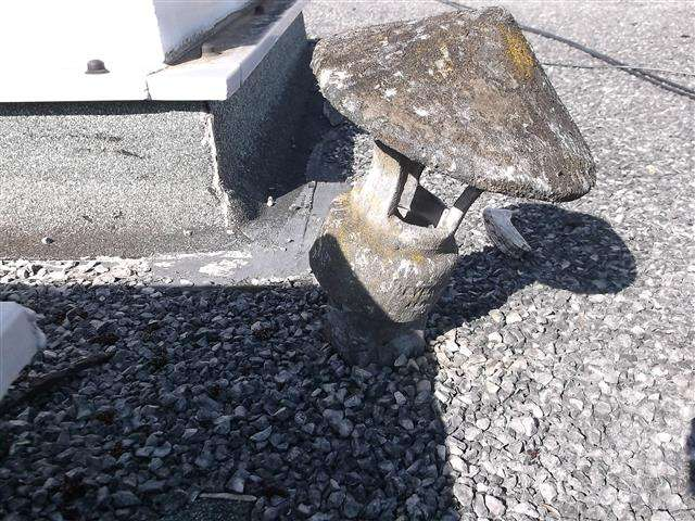 Asbestos cowl to pipe on roof