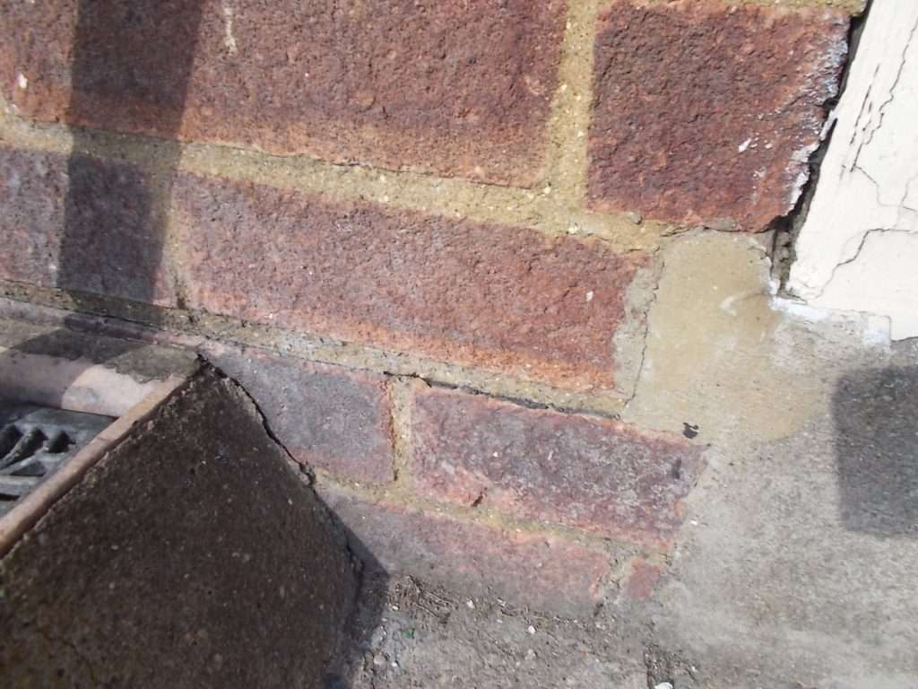 Asbestos damp proof course to low level brickwork