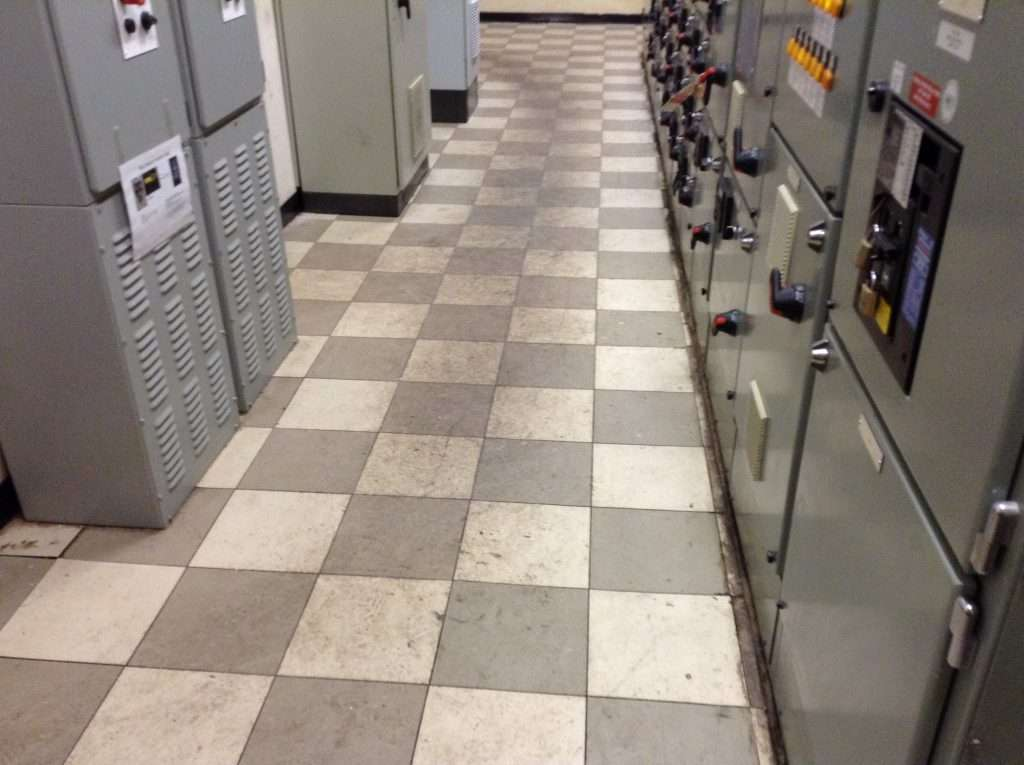 Asbestos floor tiles in factory switch gear room