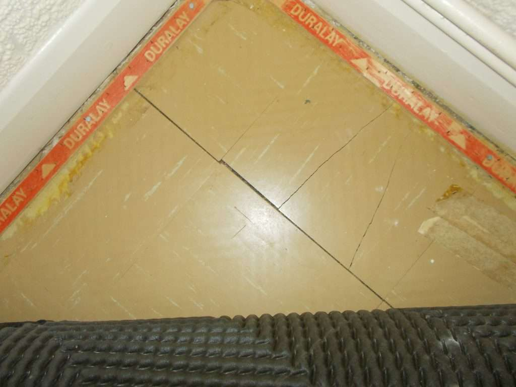 Asbestos floor tiles within apartment
