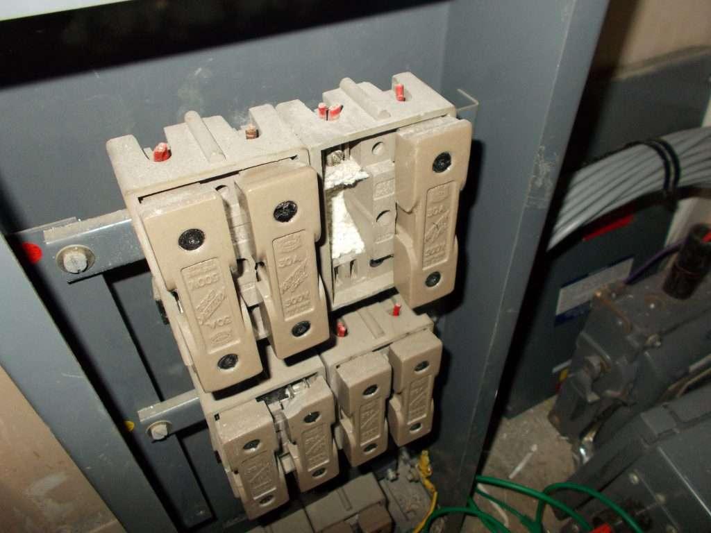 Asbestos fuse suppressor to office electrics