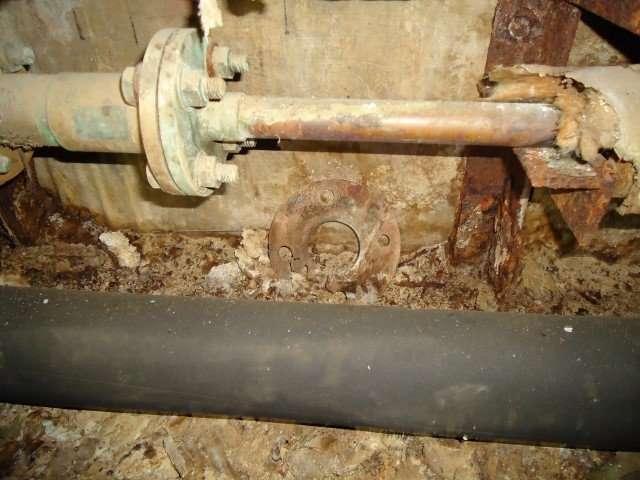 Asbestos gasket debris within duct