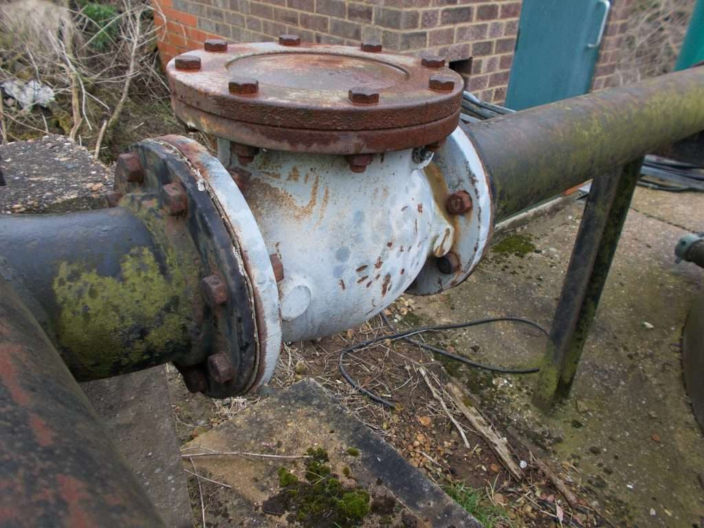 Asbestos gaskets to outside pipe work