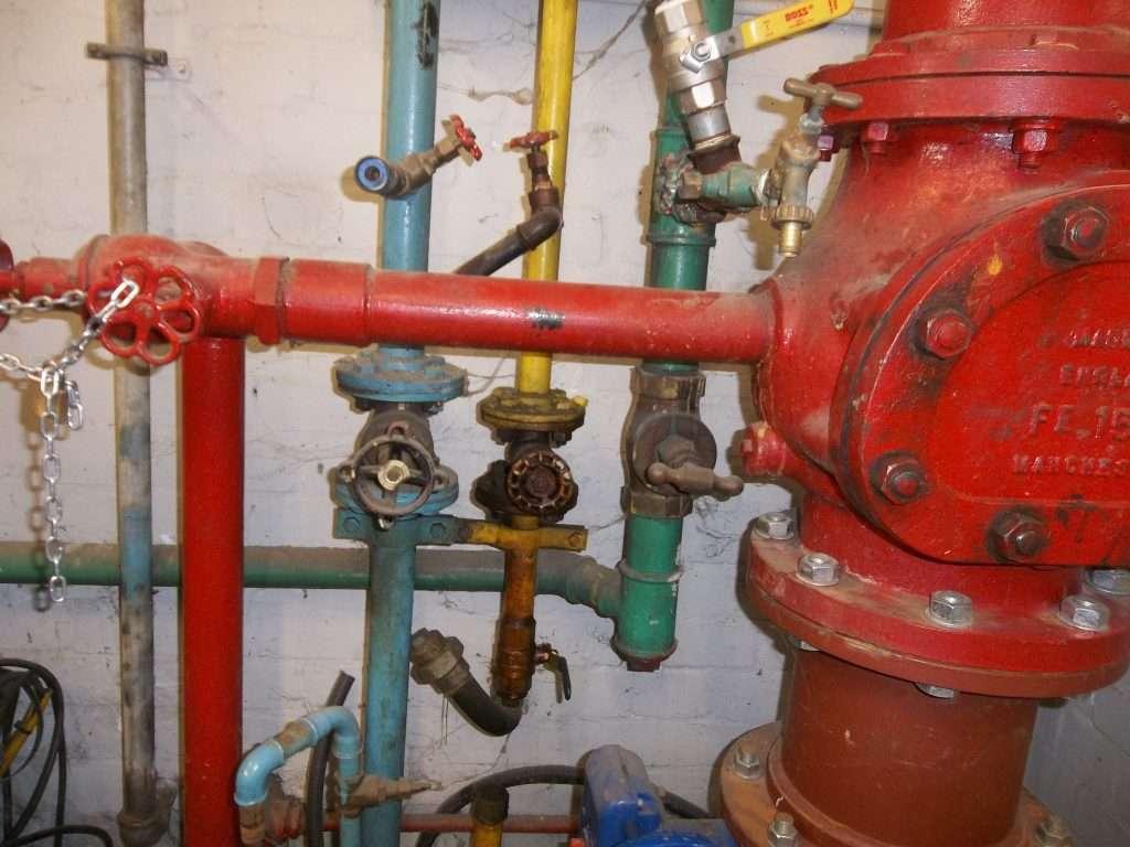 Asbestos gaskets to sprinkler system pipe work