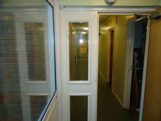 Asbestos insulating board beading to windows