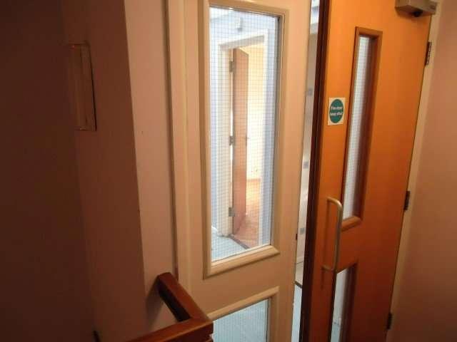 Asbestos insulating board beads to windows