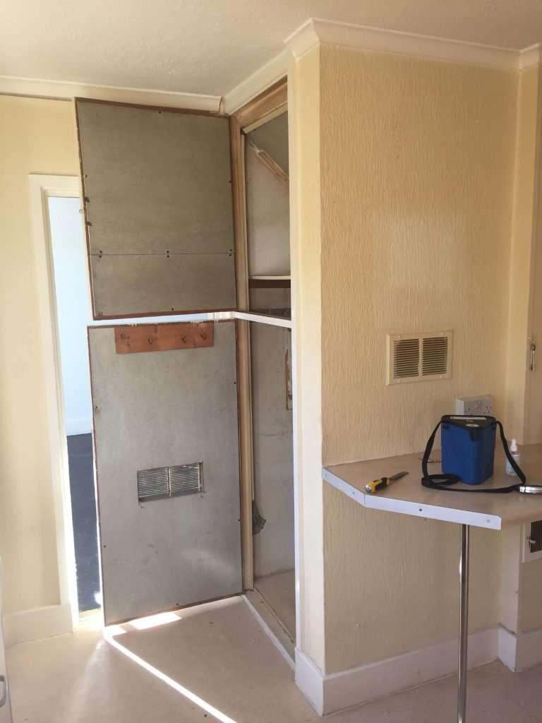 Asbestos insulating board cupboard door lining in house