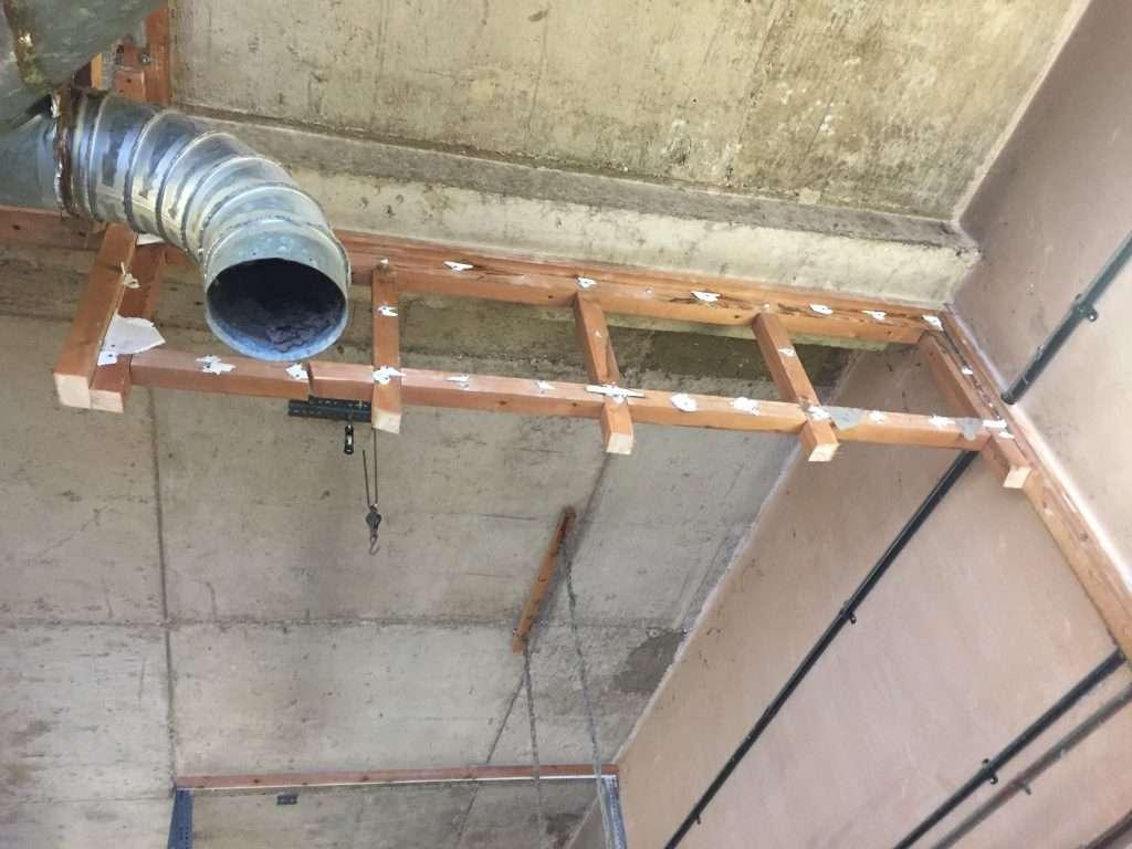 Asbestos insulating board debris to timber studwork