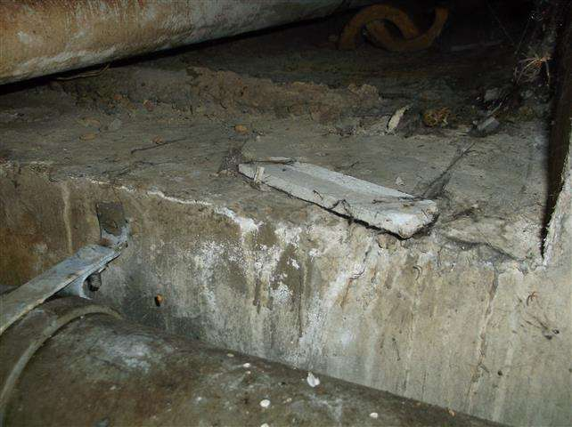 Asbestos insulating board debris within duct