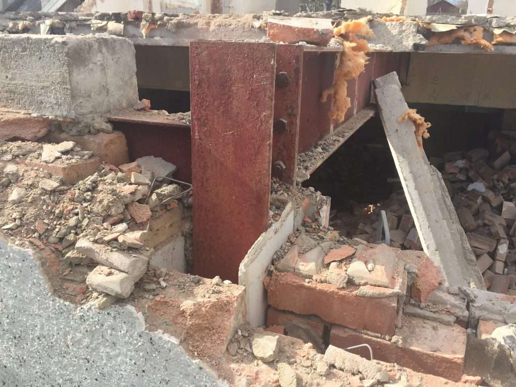 Asbestos insulating board discovered during demolition work