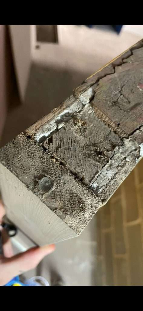 Asbestos insulating board door lining sandwiched within the timber door panel