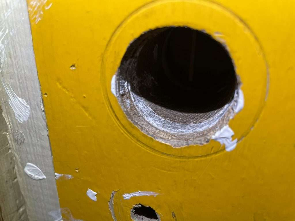 Asbestos insulating board door lining with hole drilled out for lock and handle