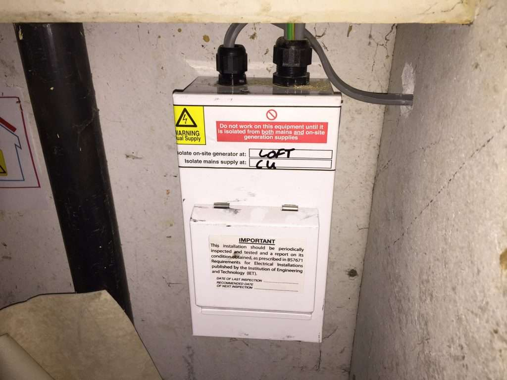 Asbestos insulating board electric cupboard lining notice the damage on the right from a new cable being installed