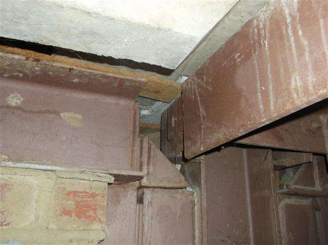 Asbestos insulating board shuttering within duct