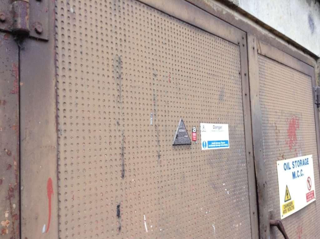 Asbestos insulating board within durasteel door