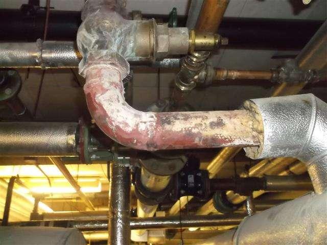 Asbestos insulation residue to pipe