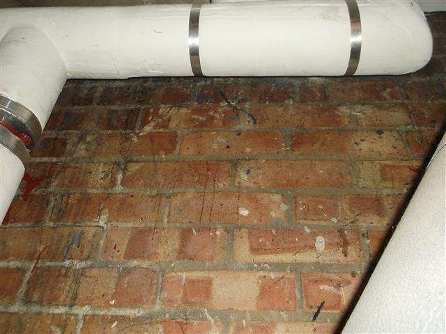 Asbestos insulation residue to wall