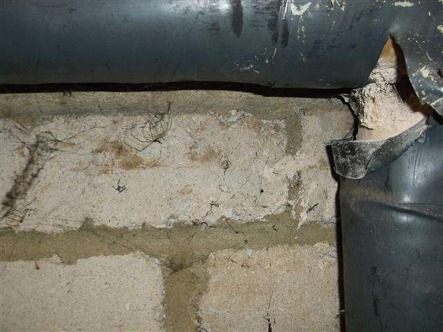 Asbestos insulation to pipe and residue to wall