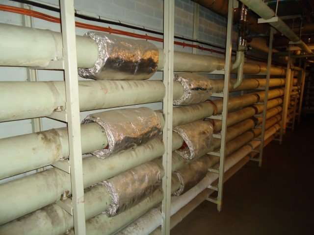 Asbestos insulation to pipes and asbestos woven covers