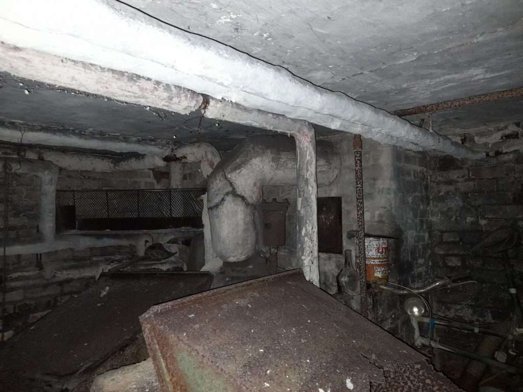 Asbestos insulation to pipes in old underground cellar