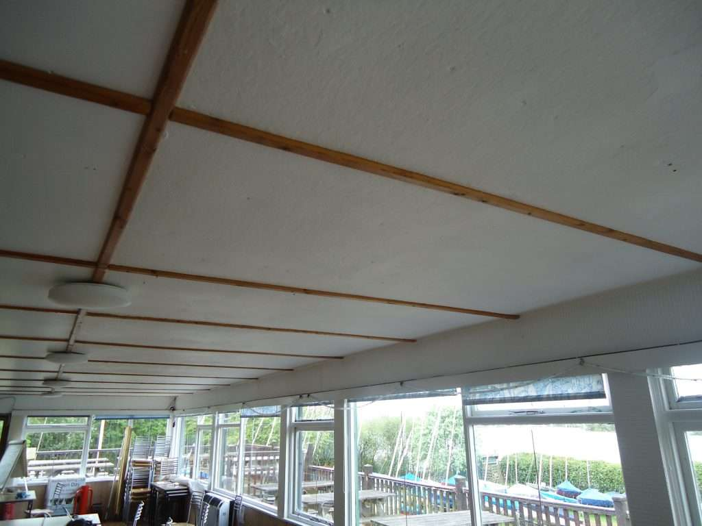 Asbestos paper lining to fibreboard ceiling