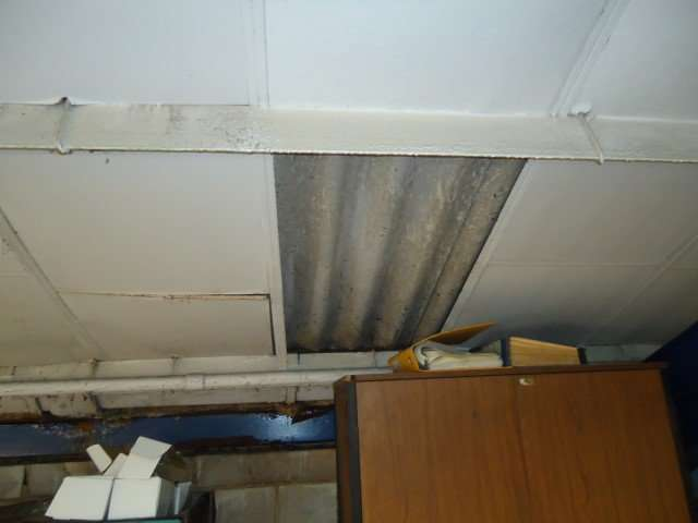 Asbestos paper lining with cement roof above