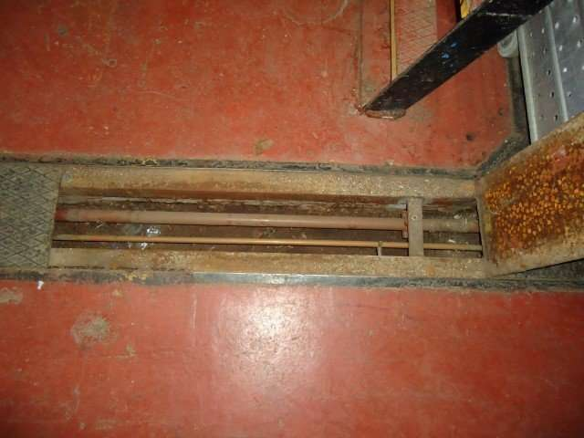 Asbestos residue within floor duct
