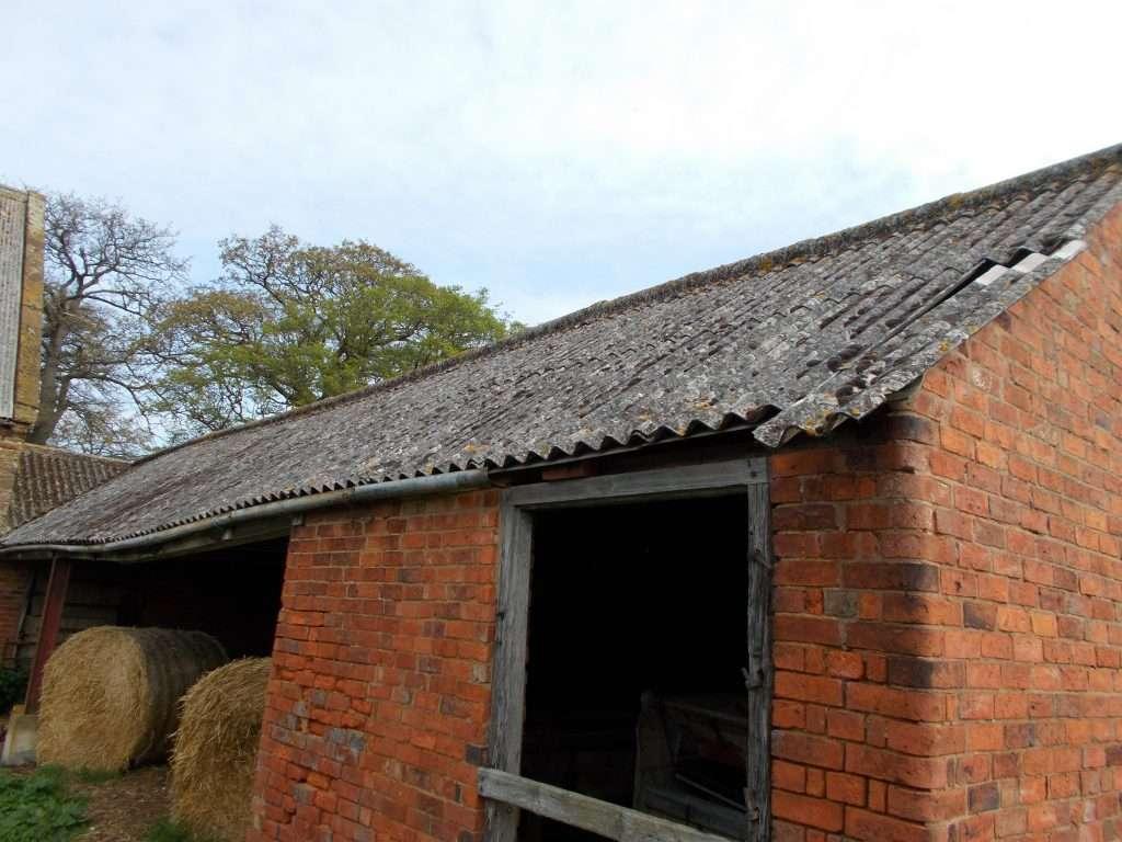 Asbestos roof to hay barn