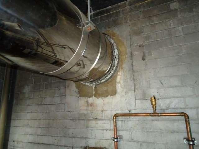 Asbestos rope around large boiler flue