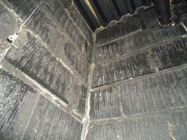 Asbestos rope to corner of breeze block walls