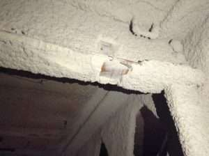 Asbestos spray coating to ceiling and beam
