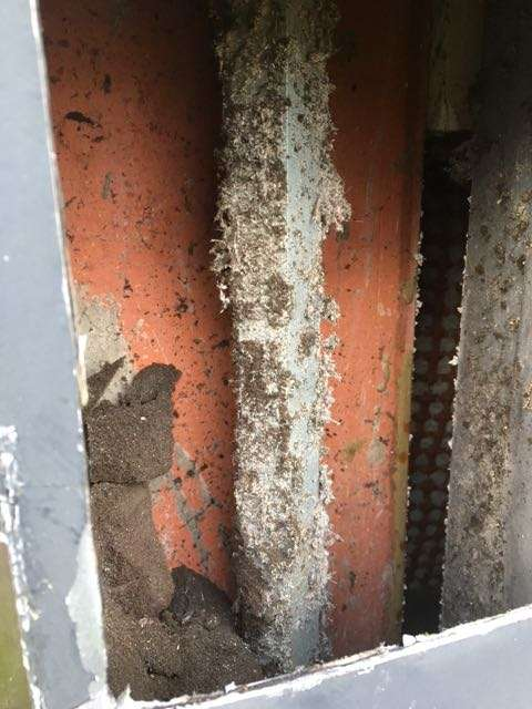 Asbestos sprayed coating to column