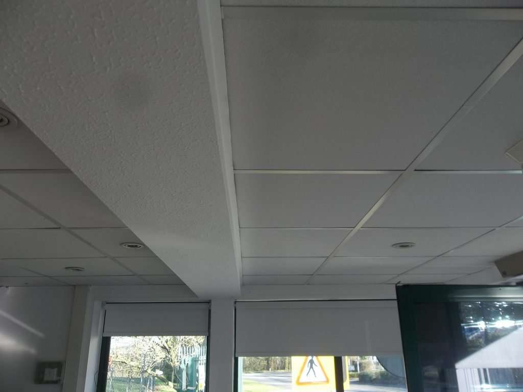Asbestos textured coating to beam in office